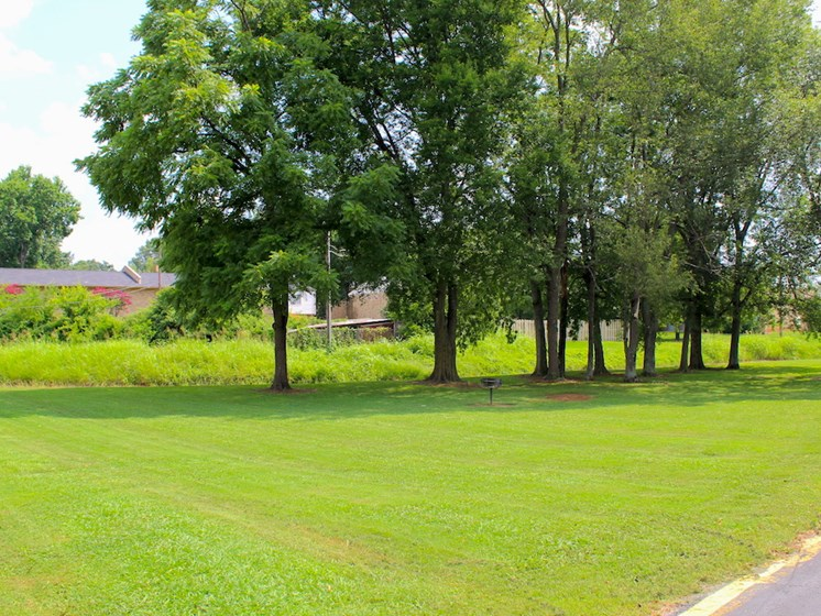 Tara Garden Apartments in Huntsville, Alabama provides a community green space with grills