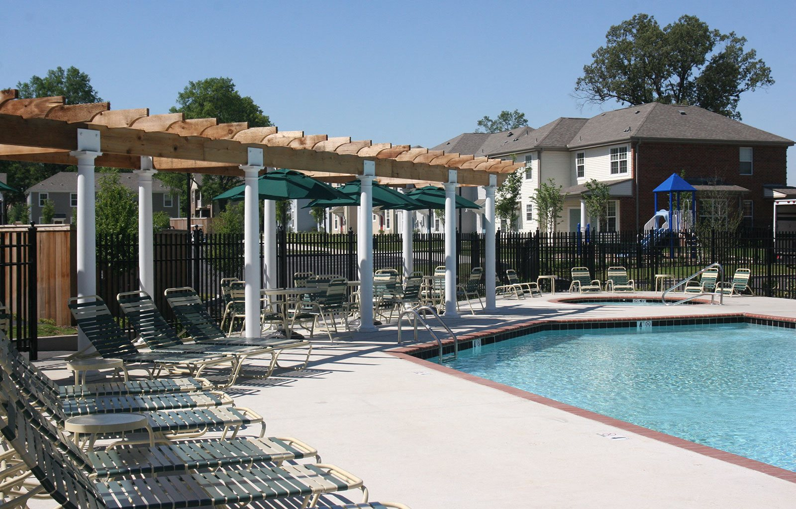 Outdoor Swimming Pool area with seating-University Place Apartments, Memphis, TN 38104
