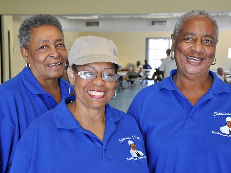 Women smiling inside community room_Lafitte,New Orleans, LA
