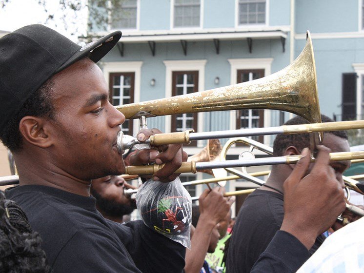 Men playing trumpets in the streets_Lafitte,New Orleans, LA