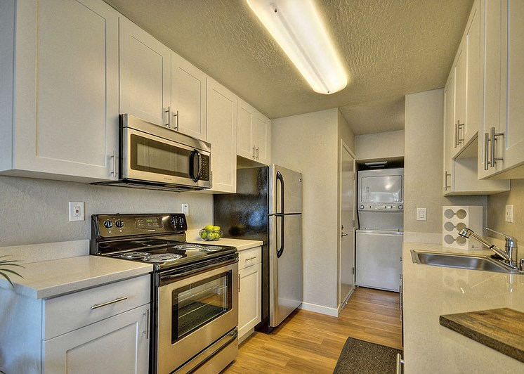 Luxury Apartment Community Kitchen with Stainless Steel Dishwasher Oven Microwave Stove and Refrigerator