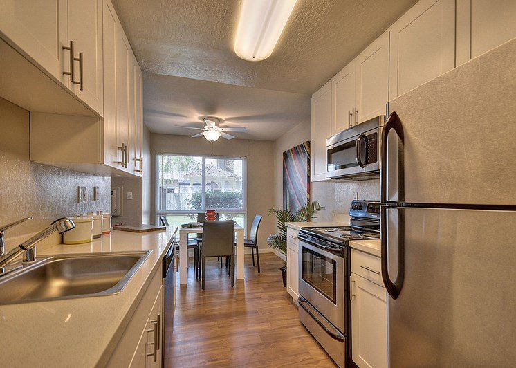 Luxury Apartment Community Kitchen with View of Dining Area