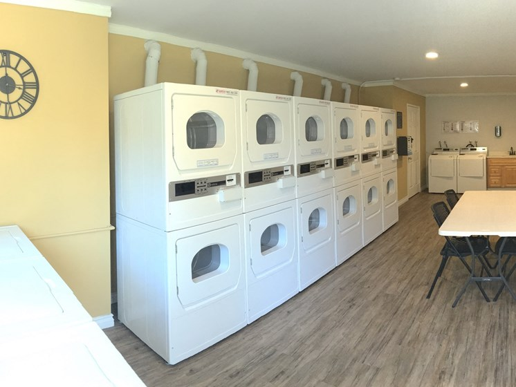 Community Laundry Room with Washers and Dryers, Table and Hardwood Inspired Floors