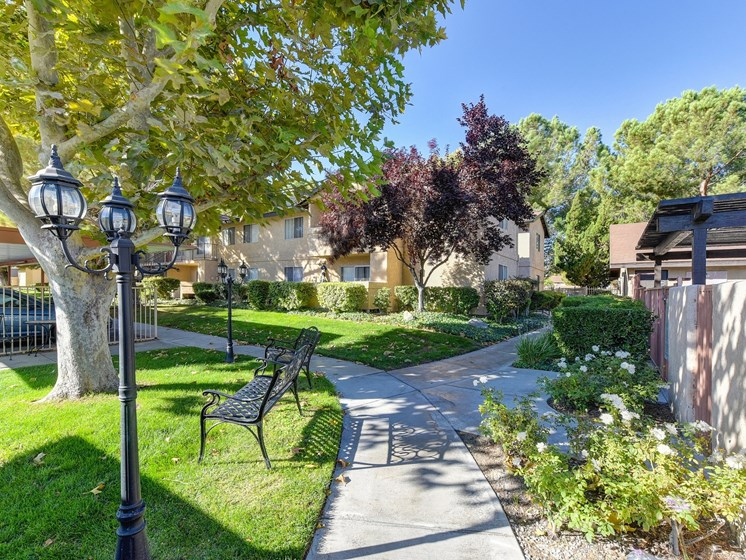 Luxury Apartment Community Property Grounds with Walking Paths and Landscaping