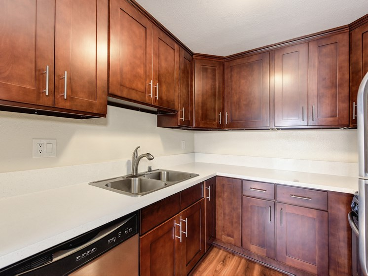 Luxury Apartment Community Kitchen with Wood Cabinets and Stainless Steel Appliances