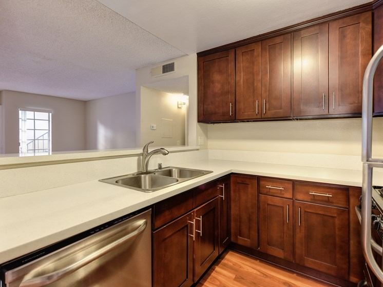 Luxury Apartment Community Open Kitchen with Wood Cabinets and Stainless Steel Appliances