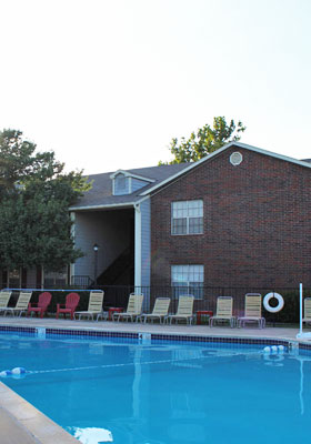 Relax by the pool at Willowpark  Apartments in Lawton