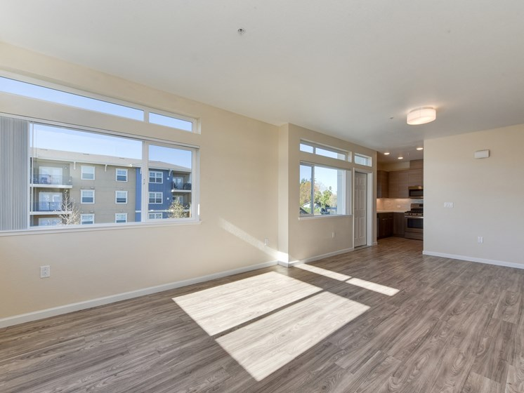 Luxury Apartment Large Living Room Hardwood Inspired Floors and Natural Light