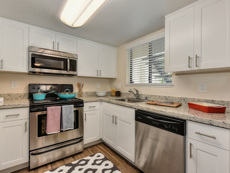 Luxury Apartment Community Kitchen with Stainless Steel Appliances and Granite Counters