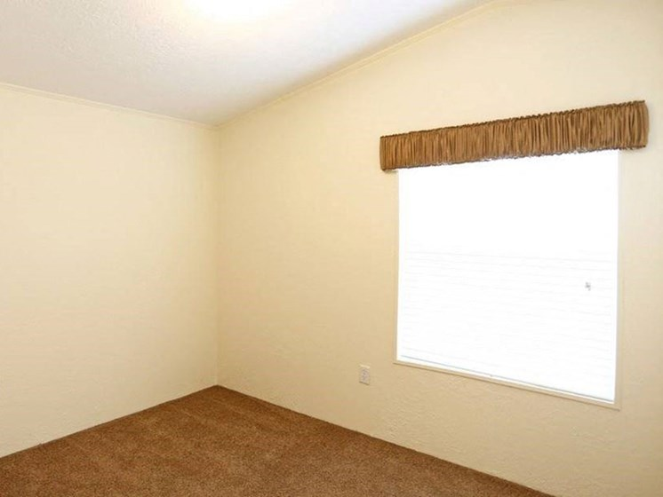 Bedroom With Window at Valley Ridge Rental Home Community in San Antonio, TX
