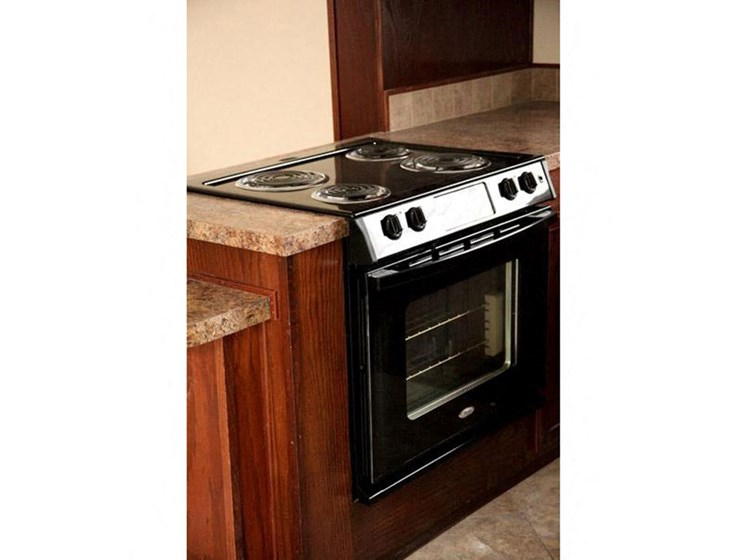 Conventional Stove in Fully-Equipped Kitchen at Valley Ridge Rental Home Community in San Antonio, TX