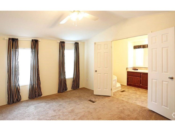 Master Bedroom With Double-Doors at Valley Ridge Rental Home Community in San Antonio, TX