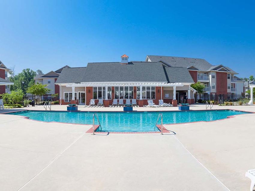 outdoor sun deck and pool behind the clubhouse