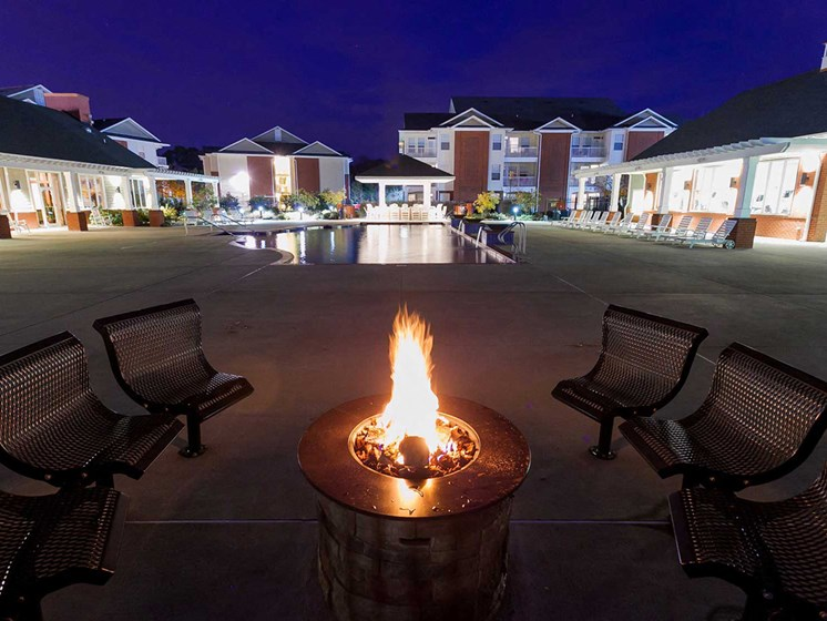 outdoor firepit at night social and entertaining spaces at 1200 Acqua