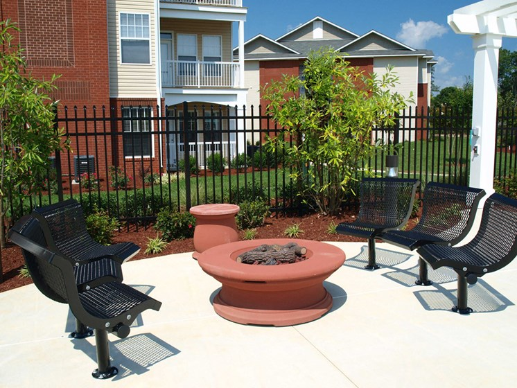 outdoor firepit and seating area daytime