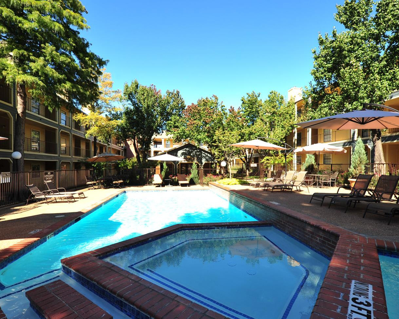 Sparking pool and sundeck at Forest Hills apartments