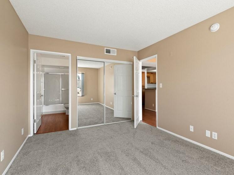 Apartments in North Hollywood, CA - Woodland Trio mirror closet carpet bedroom