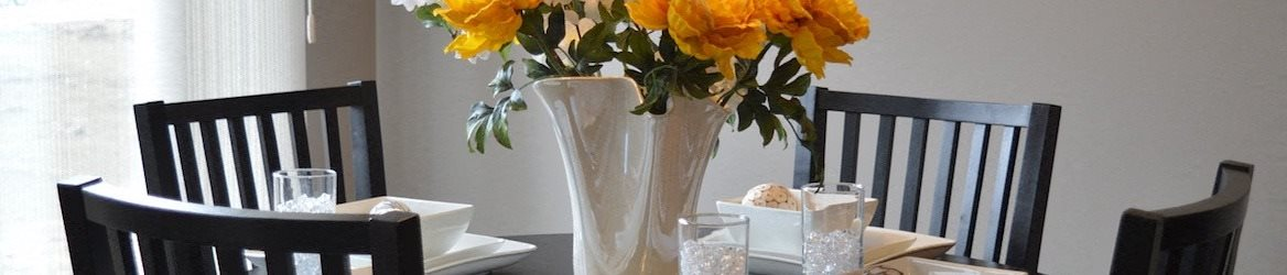 dining room table with flowers in a vase