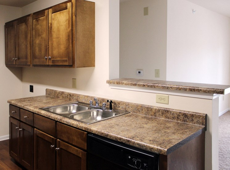 upgraded kitchen with stainless steel sink and granite look counters