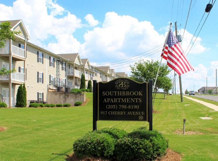 Southbrook Apartments entrance signage and American Flag