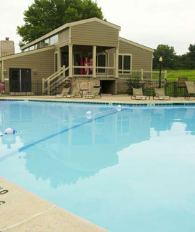 Relax by the pool at The Oaks at Prairie View Apartments in Kansas City