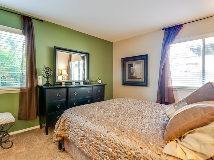 Master bedrooms at The Oaks at Prairie View Apartments in North Kansas City, MO