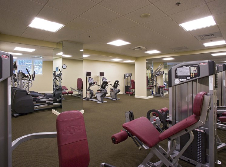 fitness center with yoga room and sauna
