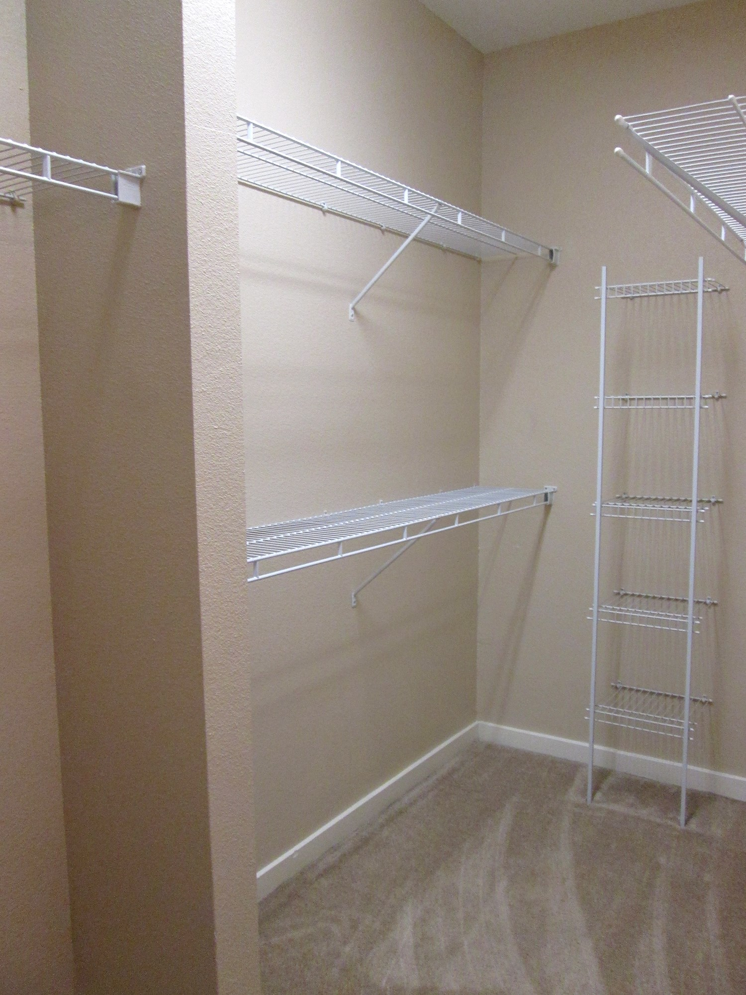 Walk-In Closet at Highlands of Grand Pointe Apartments in Lafayette, LA