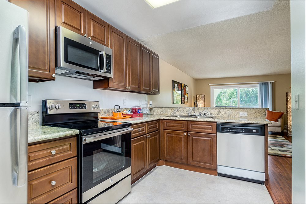 Luxury Apartments in Woodland Hills - Spacious Kitchen with Upgraded Appliances and Granite Countertops