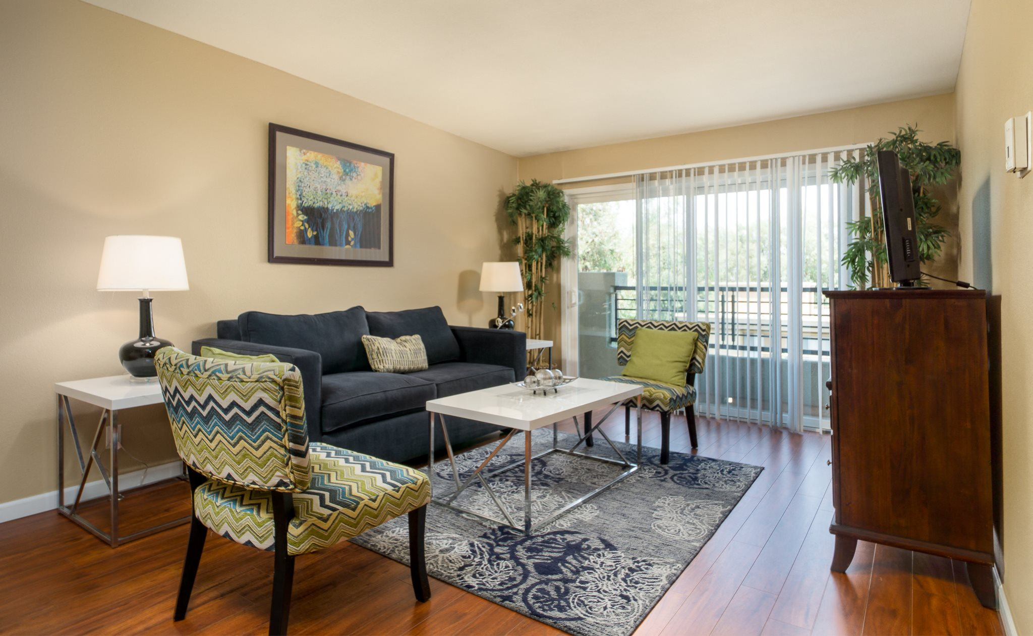 Luxury Woodland Hills, CA Apartments for Rent - The Reserve at Warner Center Living Room with Wood-Style Flooring and Access to Balcony