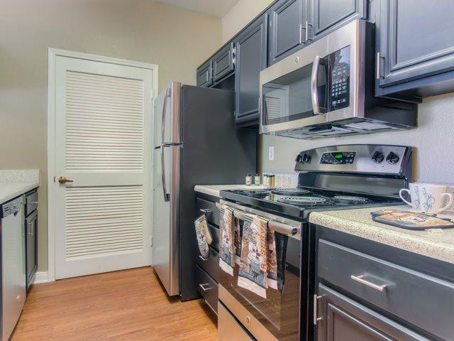 Fully equipped kitchen at The Hills at Quail Run Apartments, 5059 Quail Run Road