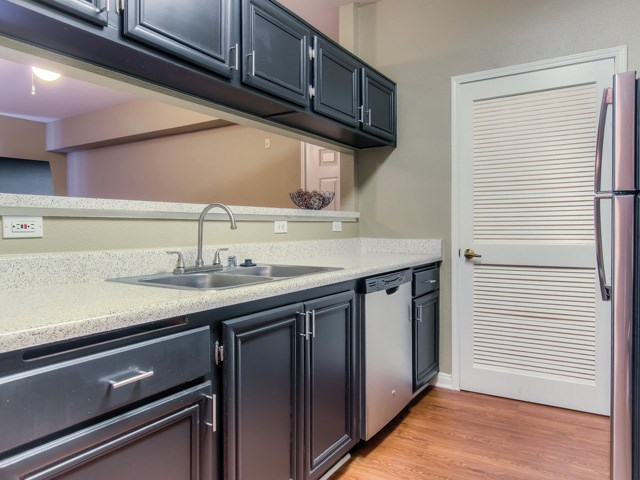 Spacious Kitchen with Pantry Cabinet at The Hills at Quail Run Apartments, 5059 Quail Run Road, CA