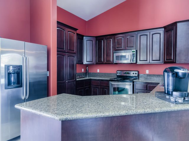 Gourmet Kitchen with Breakfast Bar and Pantry at The Hills at Quail Run Apartments, Riverside, CA