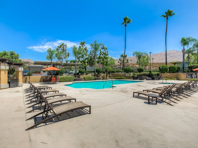 Swimming Pool with Lounge Chairs at The Hills at Quail Run Apartments, 5059 Quail Run Road, CA