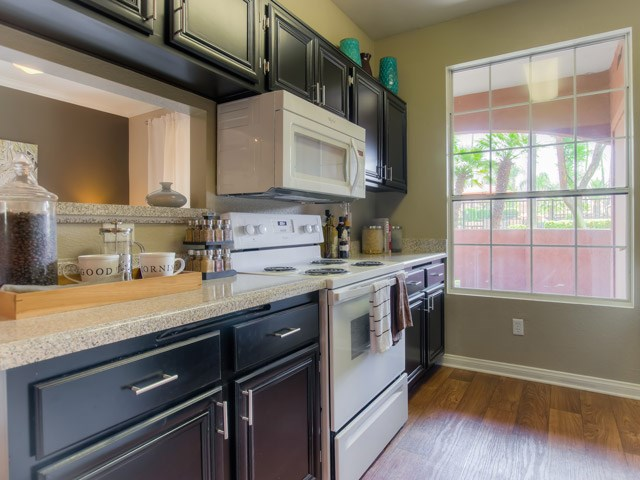 Spacious Kitchen with Pantry Cabinet at The Hills at Quail Run Apartments, CA, 92507