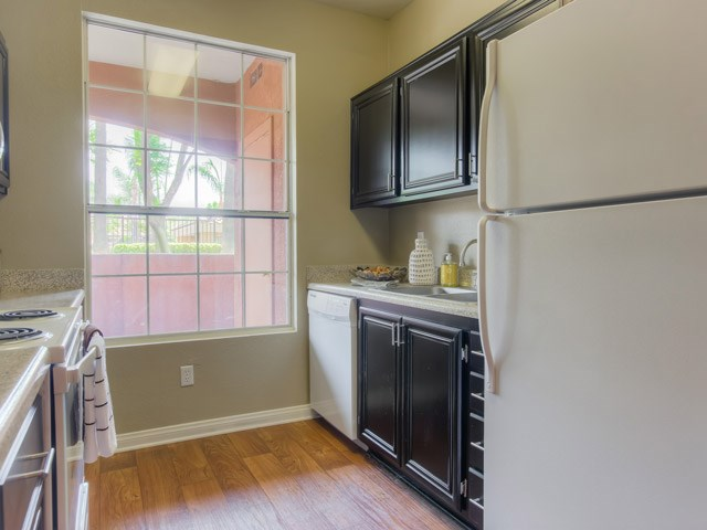 Gourmet Kitchens with Dishwasher and Disposal at The Hills at Quail Run Apartments, 5059 Quail Run Road, CA