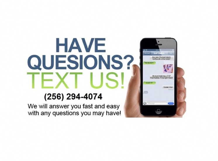 hand holding a phone saying Text Us 256-294-4074