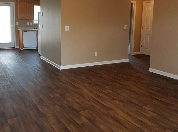 large apartment with plank flooring and ceiling fan