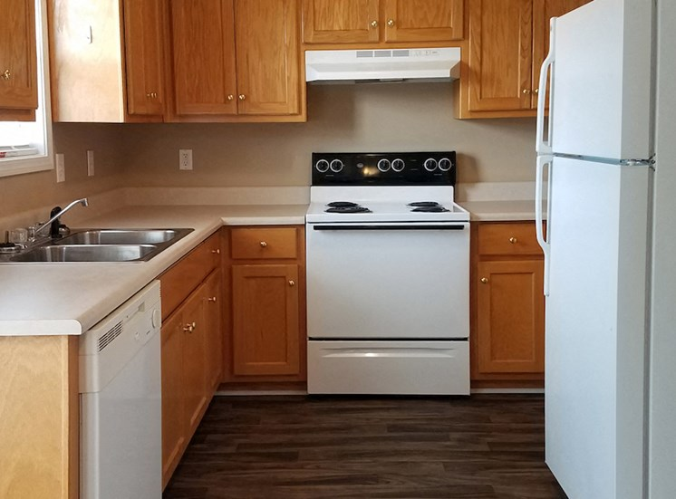 white appliances and maple cabinetry