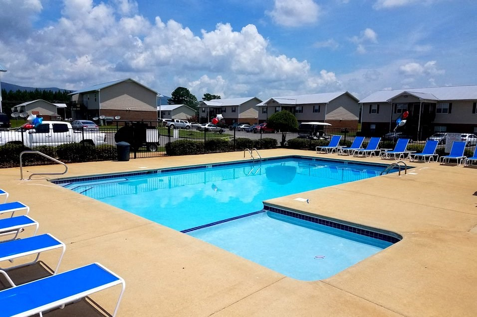 community pool with lounge furniture
