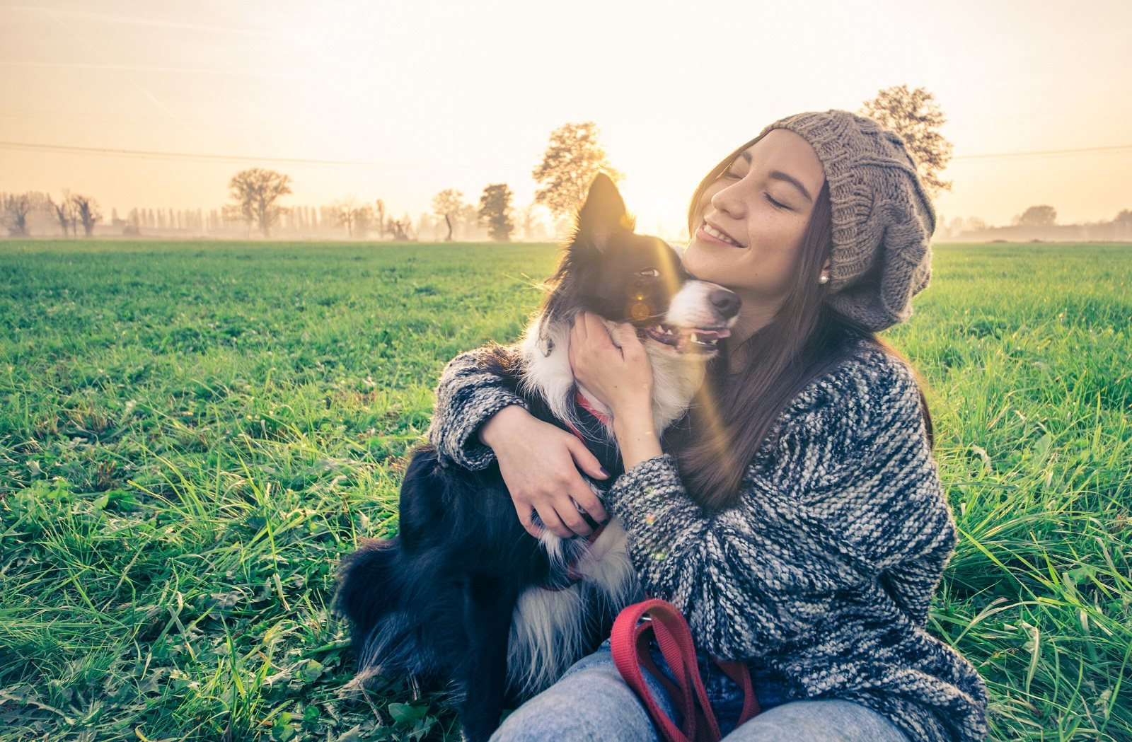 Woman playing with dog
