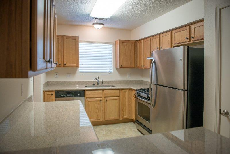 Spacious Kitchen with Pantry Cabinet at Three Waters Green apartments in Pensacola, FL  32506