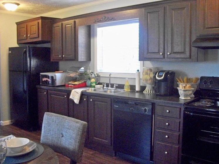 Fully-Equipped Kitchen at Pine Village Rental Home Community in Sanford, NC