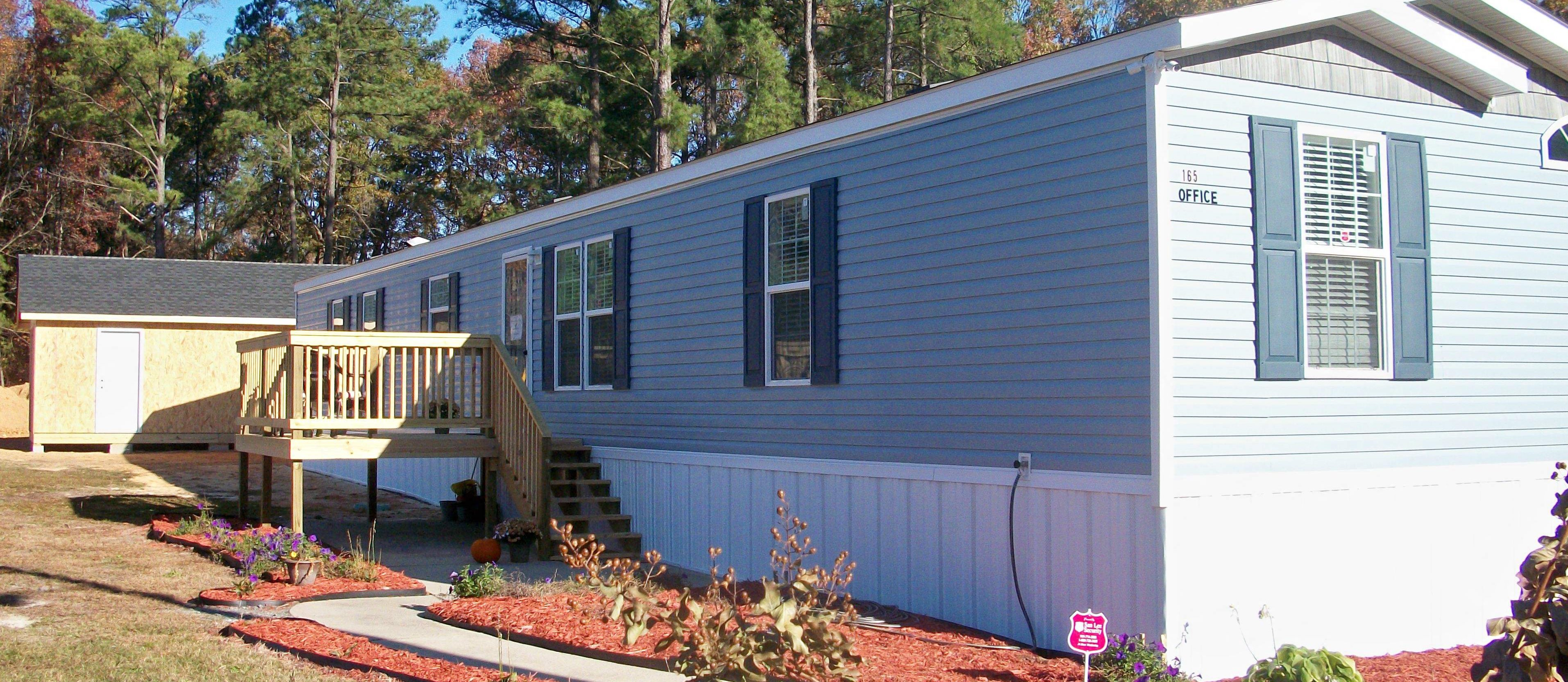 New Leasing Office Exterior at Pine Village Rental Homes in Sanford, NC 27332