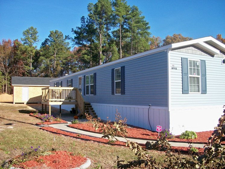 Property Exterior at Pine Village Rental Home Community in Sanford, NC