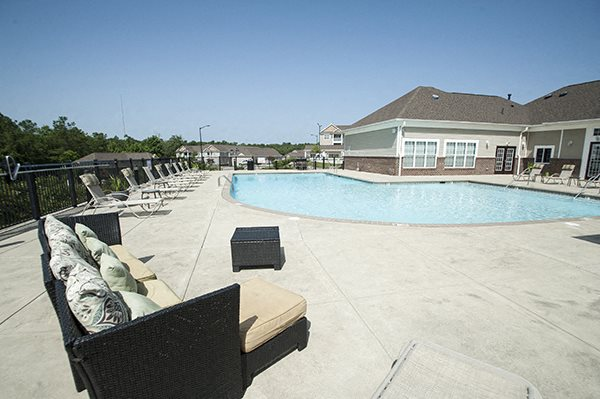 Pool Side Relaxing Area at The Enclave at Pamalee Square Apartments, Fayetteville, NC, 28301