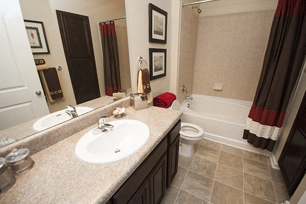 Large attached bathrooms in master suites at The Enclave at Pamalee Square Apartments, Fayetteville, NC,28301