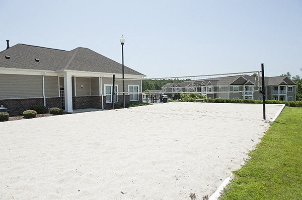 White sand volleyball court at The Enclave at Pamalee Square Apartments, Fayetteville, NC,28301