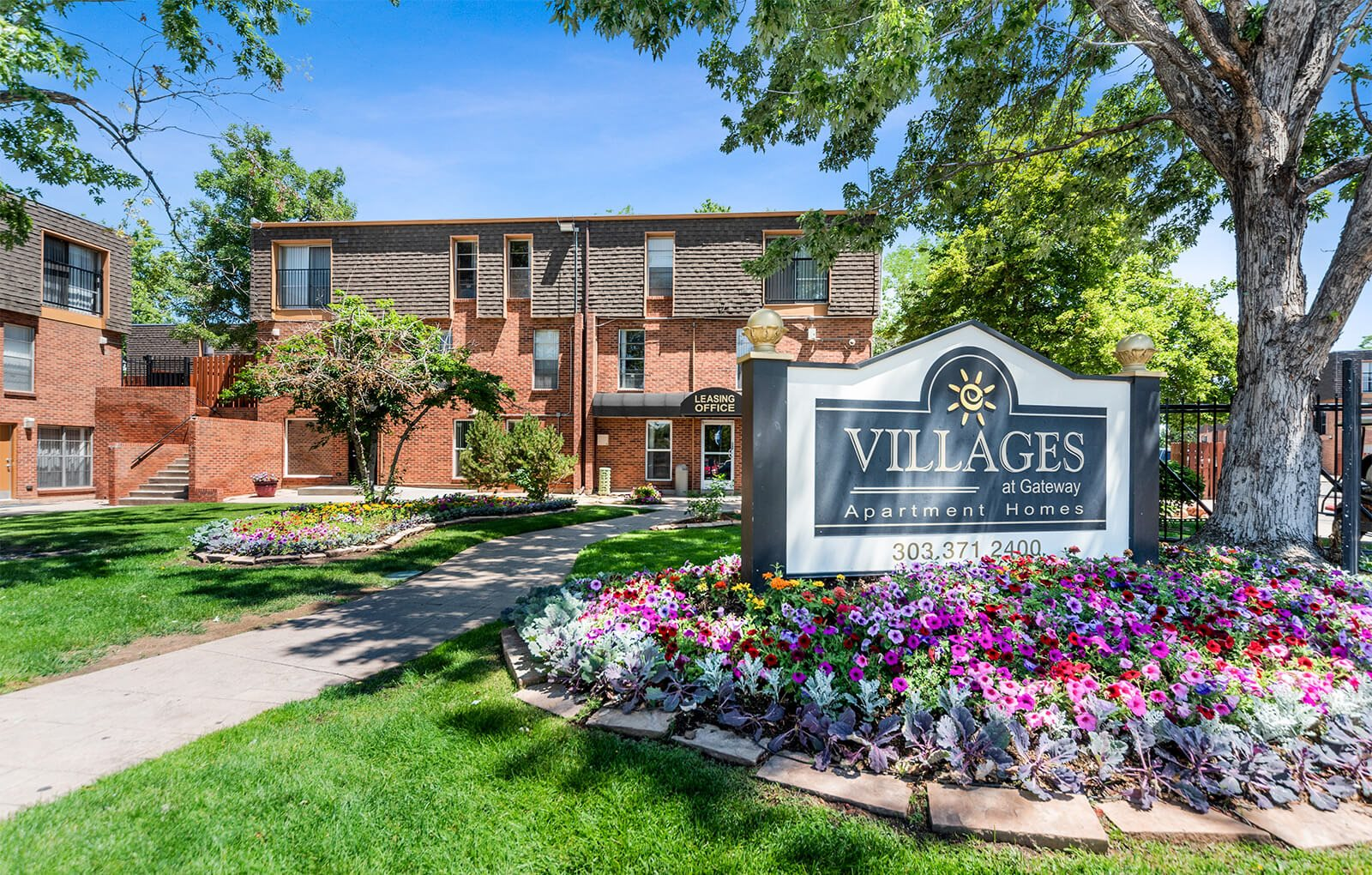 Villages at Gateway sign, landscaping and apartment exterior