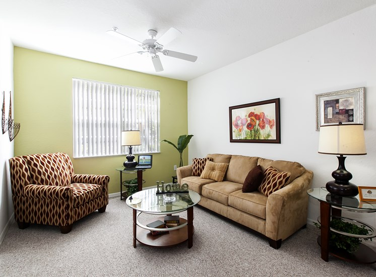 Lexington Club at Hunters Creek Apartments for rent in Deland, FL. Make this community your new home or visit other ConcordRENTS communities at ConcordRENTS.com. Living room